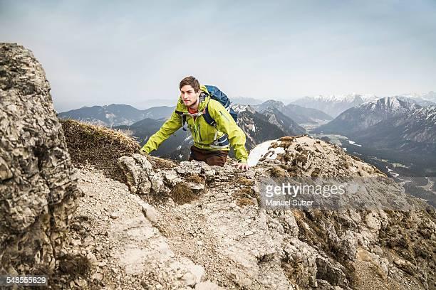 Young male hiker on Klammspitze mountain, Oberammergau, Bavaria, Germany