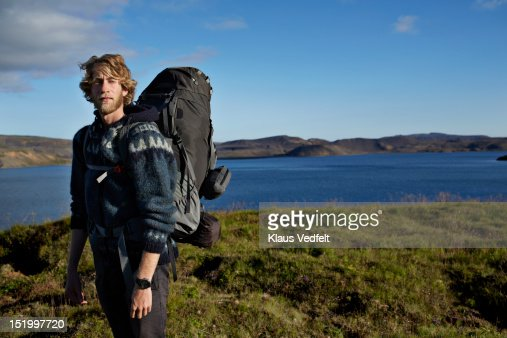 Young male hiker with backpack : Stock Photo