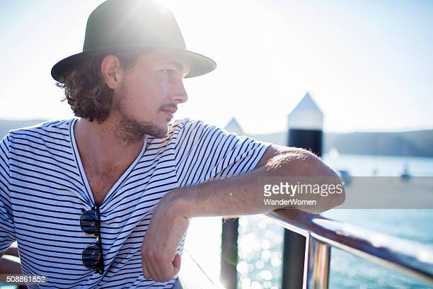Young male hipster on ferry deck Sydney Harbour