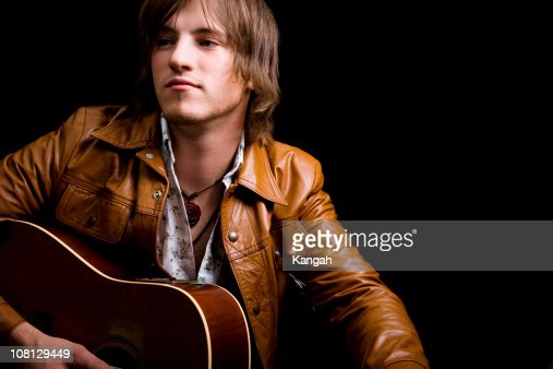 Young Male Holding Guitar
