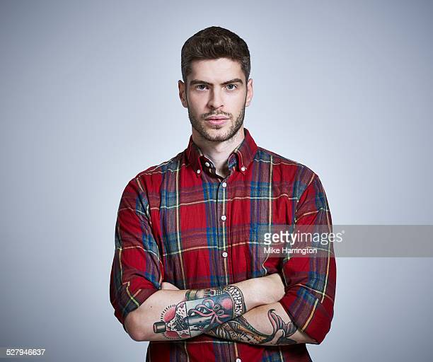 Young male in check shirt looking direct to camera