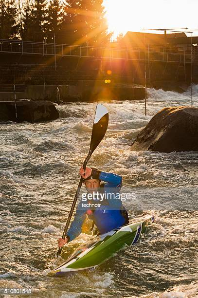 Young Male Kayaker in Whitewater Against the Sunlight