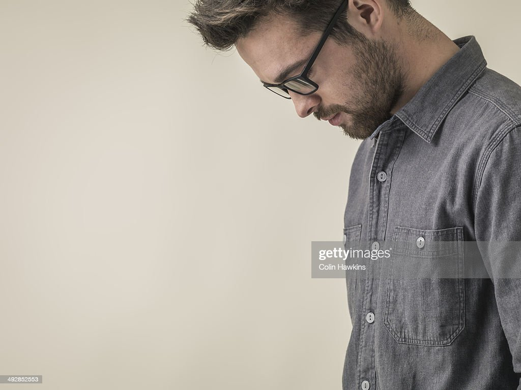 Young male looking down : Stock Photo