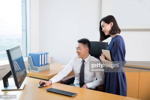young male manager working in office