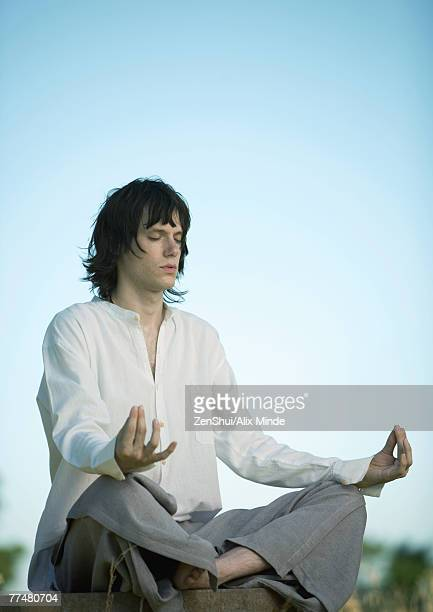 Young male meditator, eyes closed