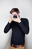 Young Male Photographer Taking Photo