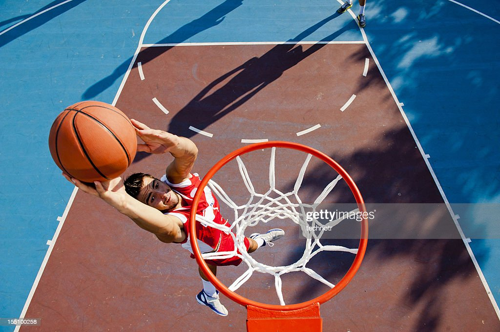 Young male player making basket : Stock Photo