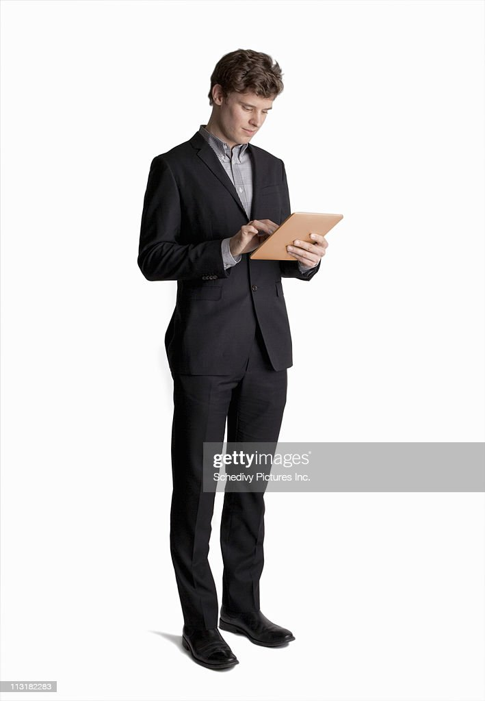 Young male professional (25-35) using a tablet pc : Stock Photo