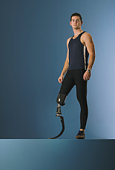 Young male runner with prosthetic leg, portrait