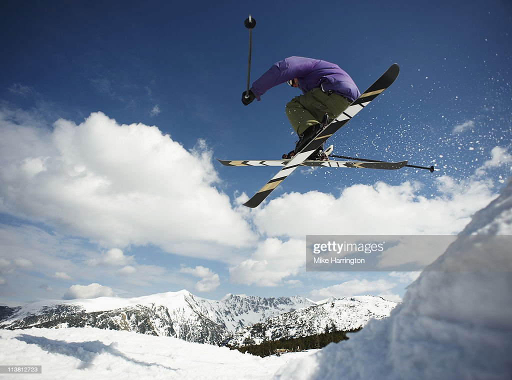 Young Male Skier Catching Air Off Bansko Cornice : Stock Photo