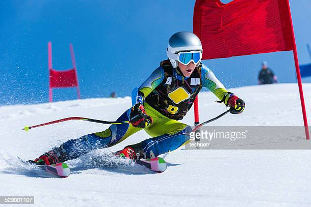 Young Male Skier Passing the Red Gate, Giant Slalom Race