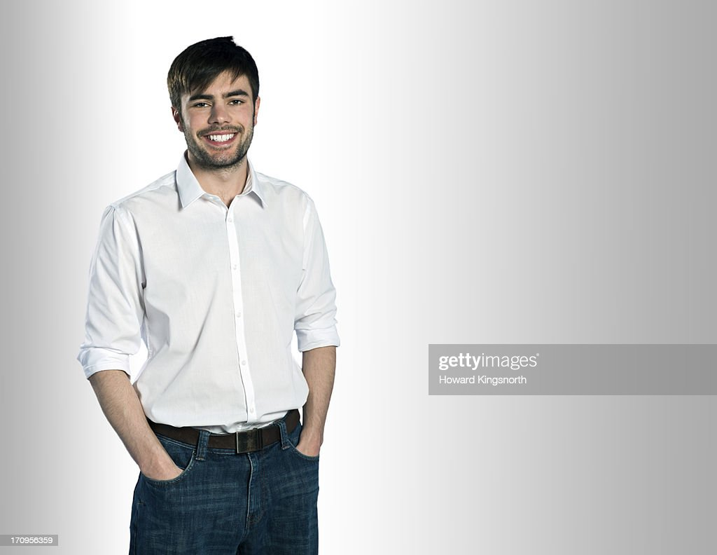 Young male smiling to camera : Stock Photo