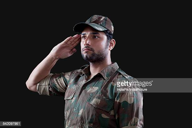 Young male soldier saluting