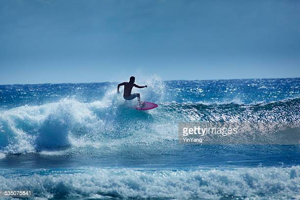 Young Male Surfer Surfing the Wave of Kauai Hawaii