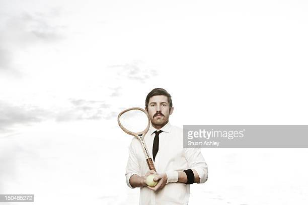 Young male tennis portrait