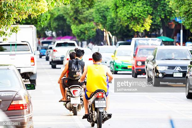 Young male thai on motorcycles