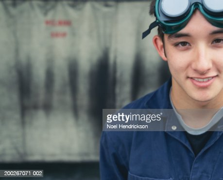 Young male welding student outside shop, smiling, close-up, portrait : Stock Photo