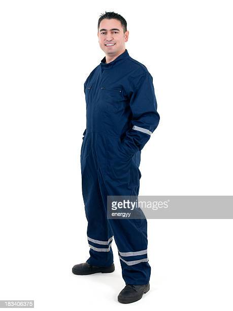 Young male worker in blue uniform against white background