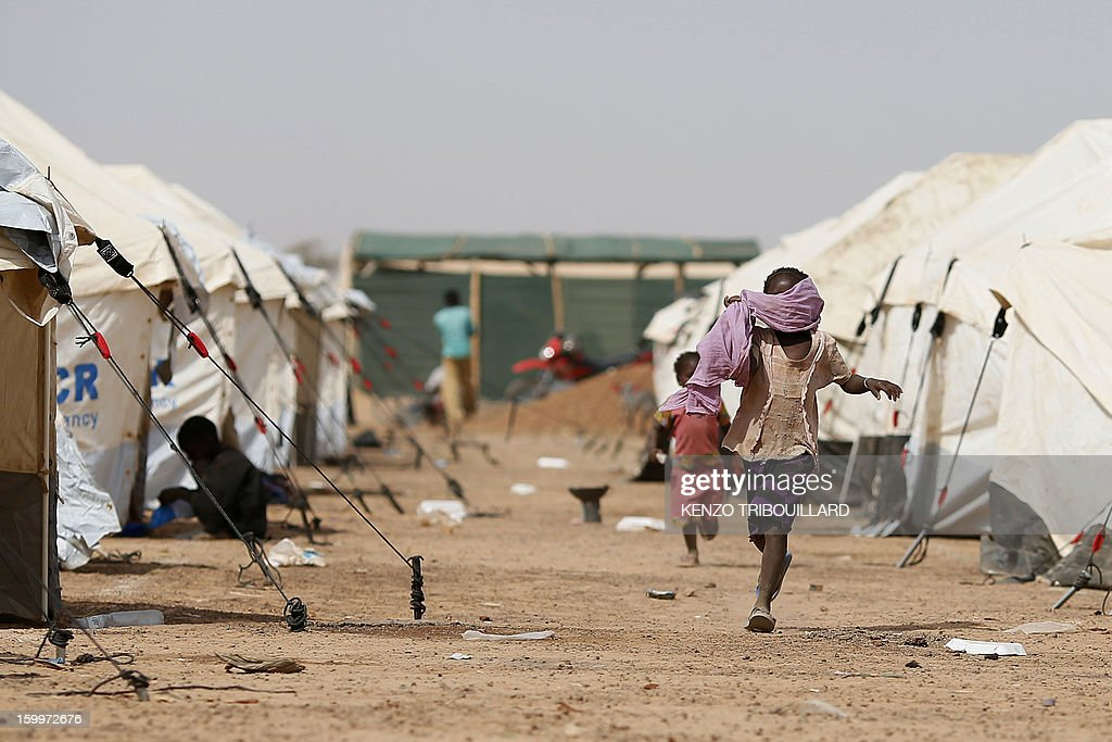 A young Malian girl runs on January 24, 2013 at a refugee camp set in Menteao near the Malian border. The conflict in Mali has caused nearly 150,000 people to flee the country, while about another 230,000 are internally displaced, the UN humanitarian agency said on January 15, 2013. According to OCHA, the UN High Commissioner for Refugees has registered 144,500 refugees in neighbouring countries -- 54,100 in Mauritania, 50,000 in Niger, 38,800 in Burkina Faso and 1,500 in Algeria.