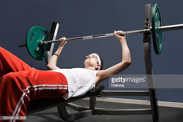 Young man about to lift weight in gym