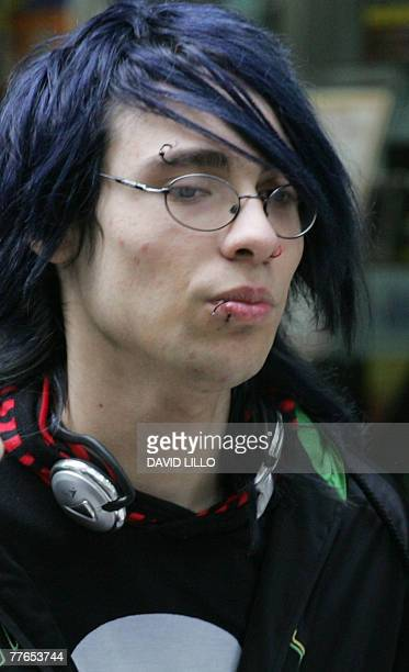 A young man adhering to the 'emo' movement strolls around Paseo Ahumada 31 October 2007 in Santiago The Chilean capital experiences a boom of...