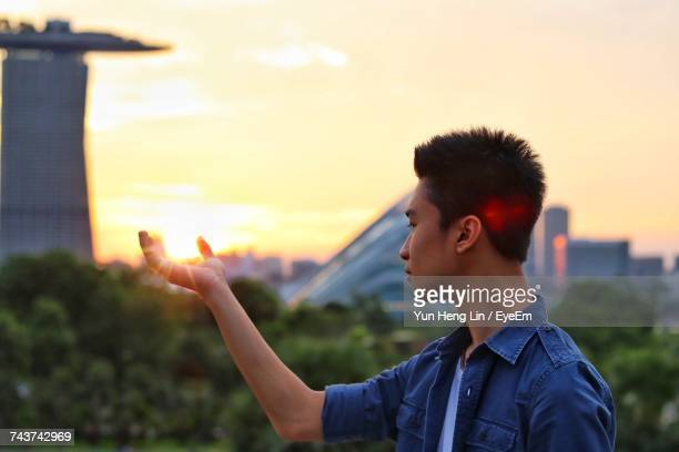 Young Man Against Sky During Sunset