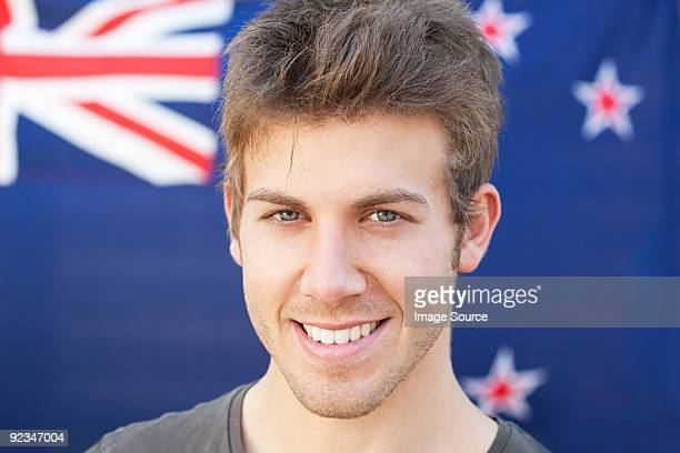 Young man and and new zealand flag
