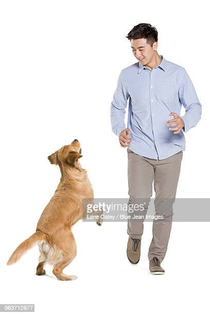 Young man and golden retriever