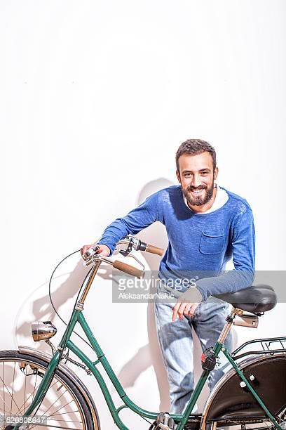 Young man and his bicycle