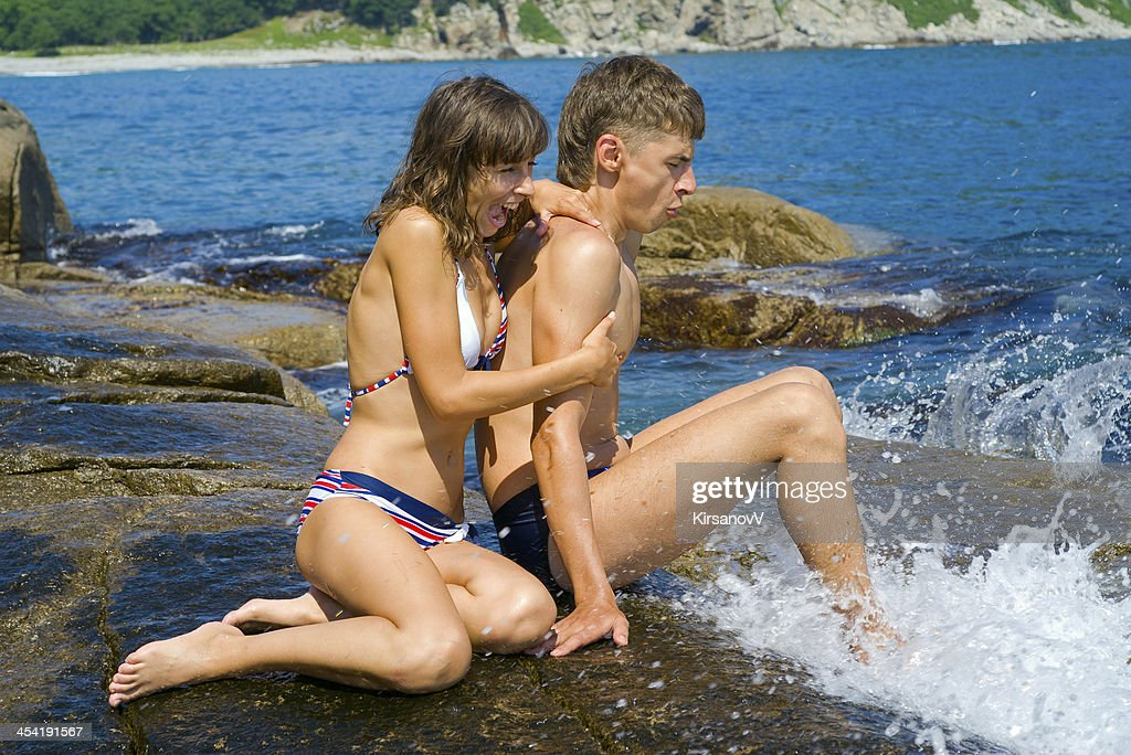 Young man and woman at surf : Stock Photo