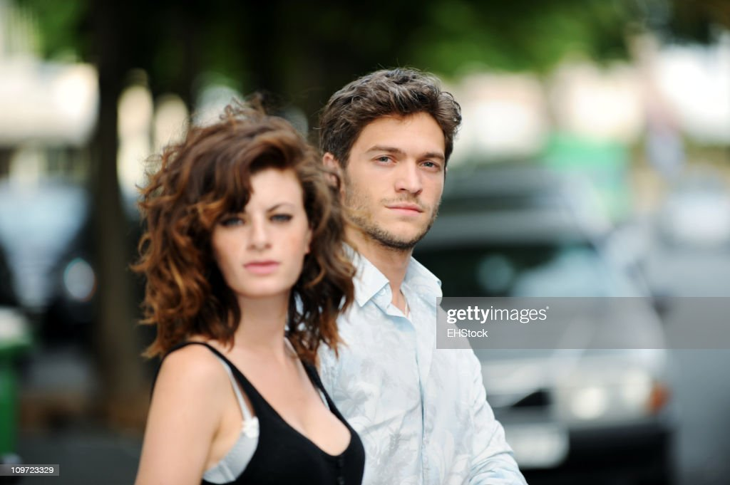 Young Man and Woman Crossing Paris Street : Stock Photo