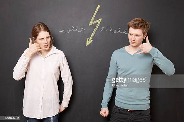 Young man and woman fighting on the phone