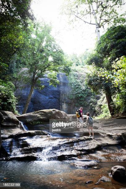 Young Man and Woman Hiking a Tropical River