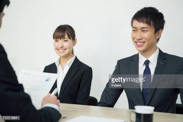 Young man and woman in job interview