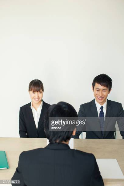 Young man and woman in job interview, smiling