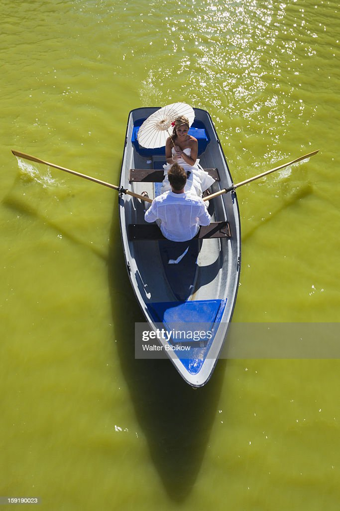 Young man and woman in rowboat : Stock Photo