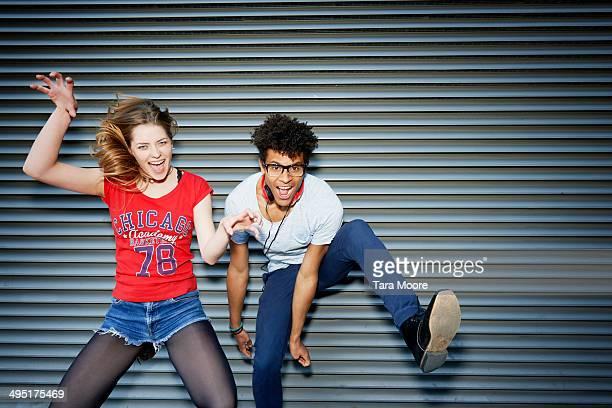 young man and woman jumping having fun