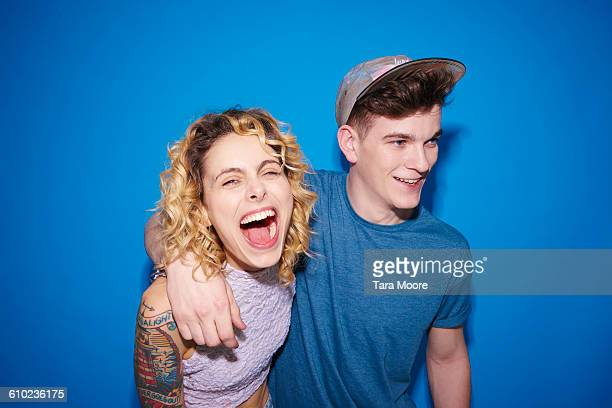young man and woman laughing and smiling