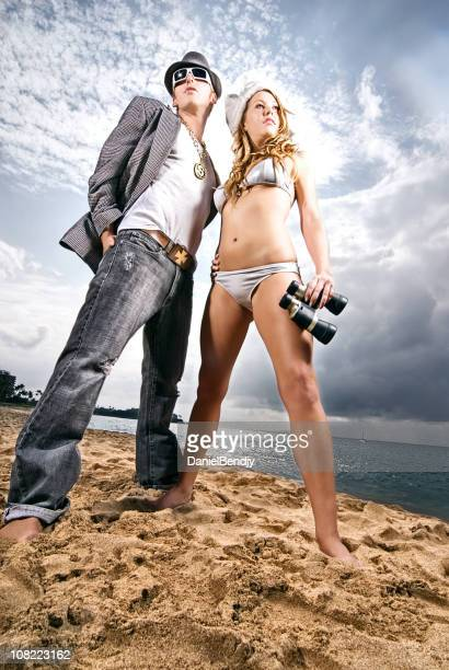 Young Man and Woman on Beach with Binoculars