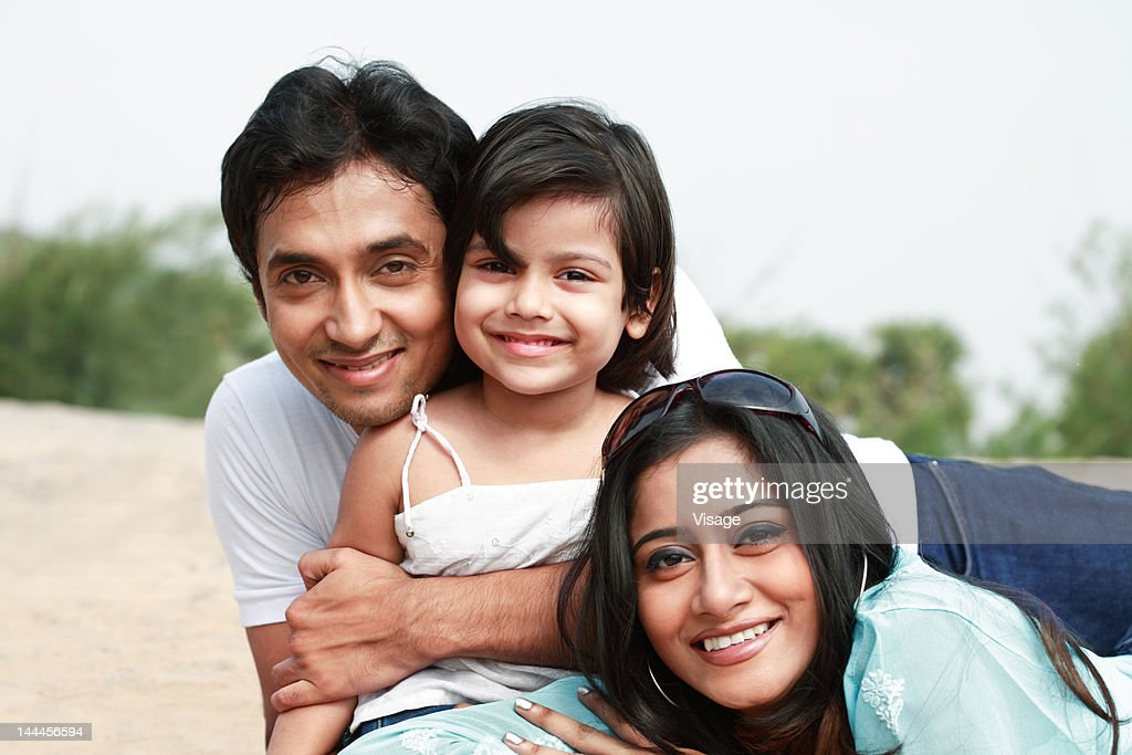 Young man and woman with their kid : Stock Photo