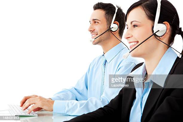A young man and woman working as help desk operators