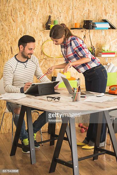Young man and woman working at modern office