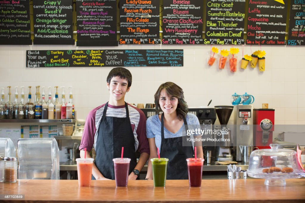 Young man and woman working in cafe