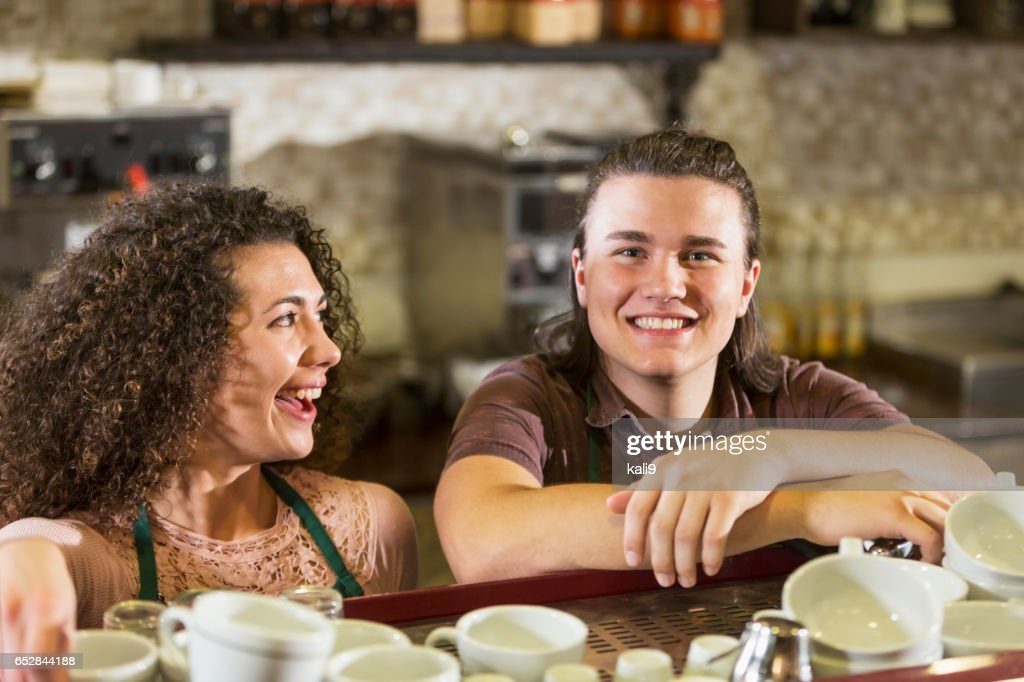 Young man and woman working in coffee shop : Stockfoto