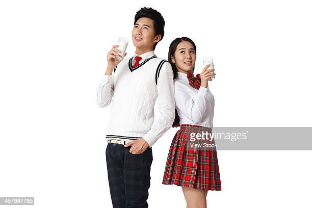 Young man and young woman drinking milk