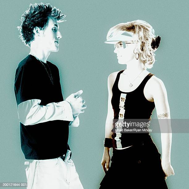 Young man and young woman facing each other (Digital Enhancement)