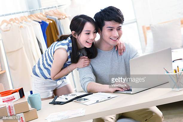 Young man and young woman in design studio