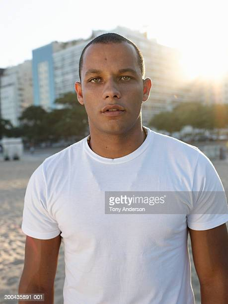 Young man at beach, portrait