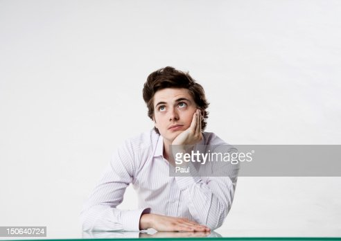 Young man at desk looking up