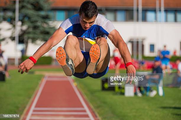 Young man at long jump